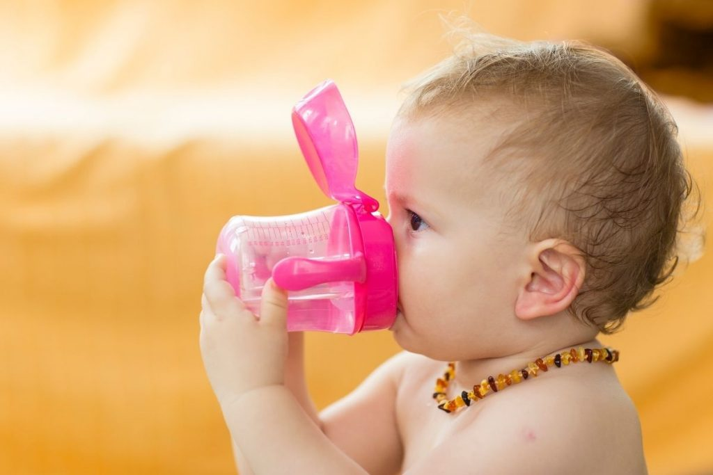 A baby wearing a teething necklace, which is considered not safe by paediatricians.